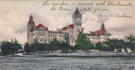 1908 Postcard.Old Main with bluebonnets