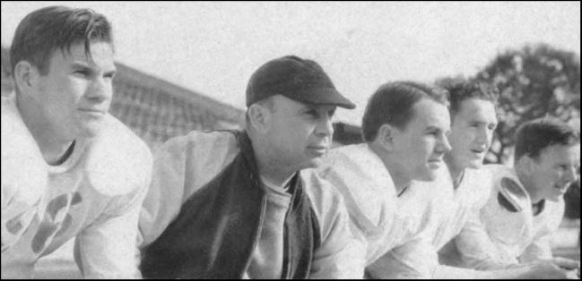35.1938.Coach Bible at football practice.